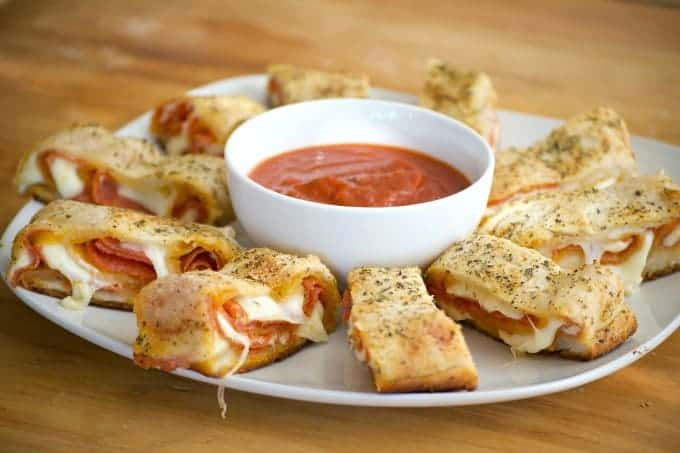 Pepperoni Bread - refrigerated pizza dough, pepperoni and provolone cheese rolled up to make one heck of an appetizer. Remember the marinara for dunking!