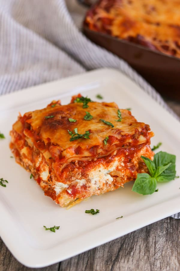 Lasagna made of layers of noodles, meat sauce, mozzarella cheese and ricotta cheese.