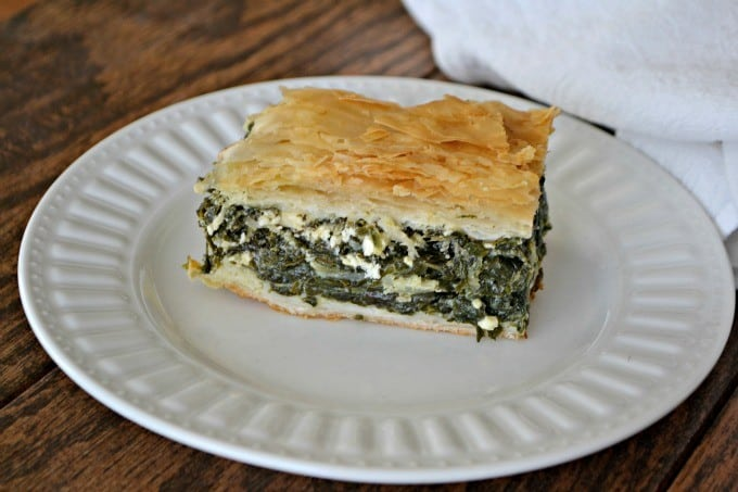 Spinach, onion, herbed Feta cheese in between layers of Phyllo dough create an easy and delicious Spanakopita that makes plenty to serve everyone.