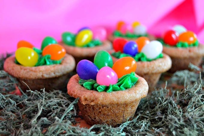 Cookies decorated with green frosting,, jelly beans and a hidden surprise inside - a Mini Cadbury Creme Egg! The perfect Easter treat!