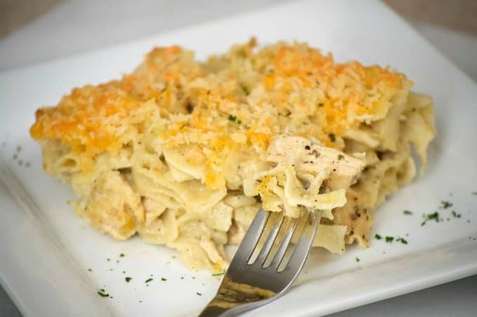 Chicken Noodle Casserole - cooked chicken and noodles mixed with a savory flavored sauce. A weeknight meal made even easier with a rotisserie chicken!