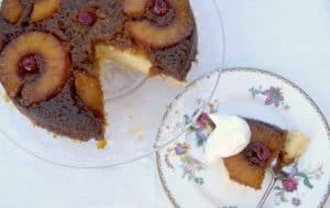 A soft cake covered with a delicious brown sugar crust, sliced pineapples and maraschino cherries -YUM!