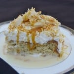 Banana Tres Leches Cake - an outstandingly moist and delicious cake flavored with banana, topped with toasted coconut and sliced bananas.