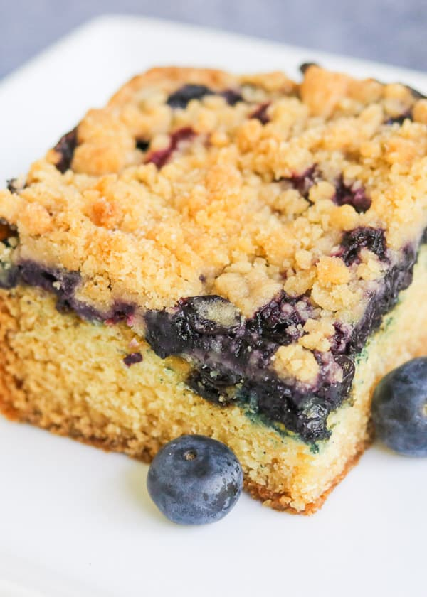 Cake with blueberries and a crumb topping.