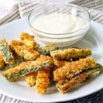 Bake Parmesan Zucchini Sticks with Ranch dressing.