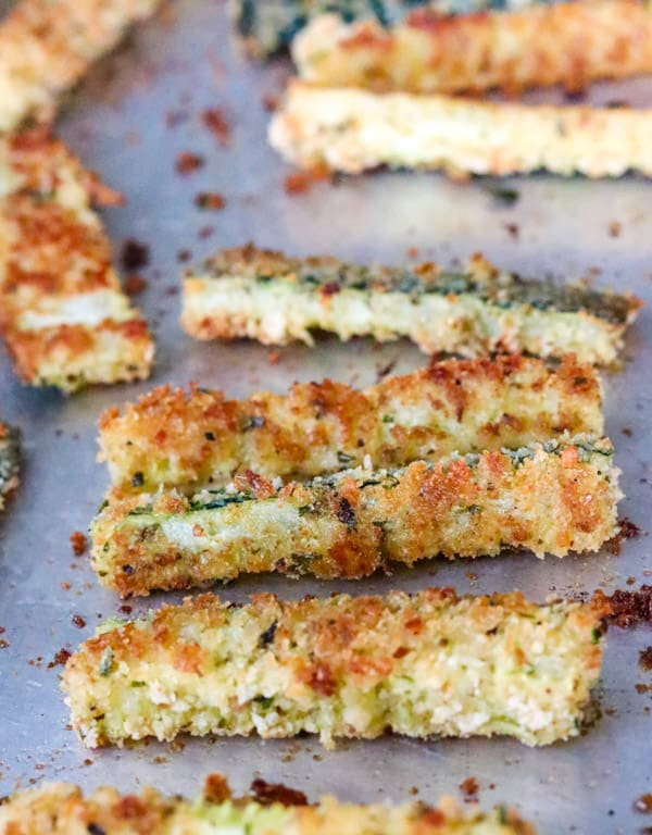 Baked Parmesan Zucchini sticks on a baking sheet.
