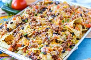Nachos on a baking sheet.