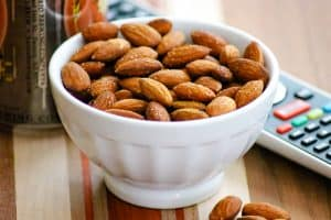 Bowl of Baked Spiced Almonds in a small white bowl.