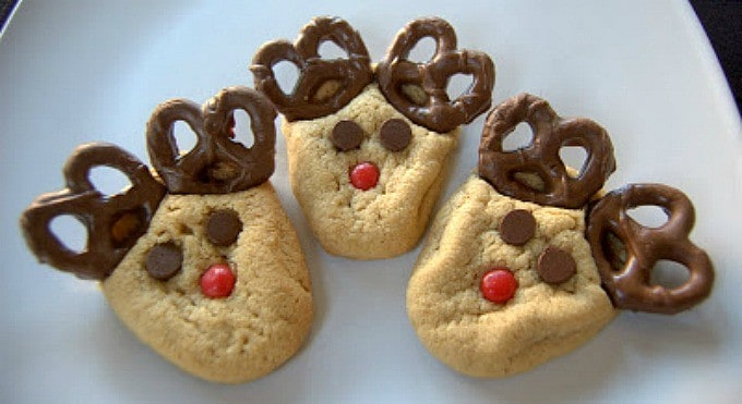 Peanut Butter cookies with chocolate covered pretzels, cinnamon red hots and chocolate chips make these fun holiday cookies!
