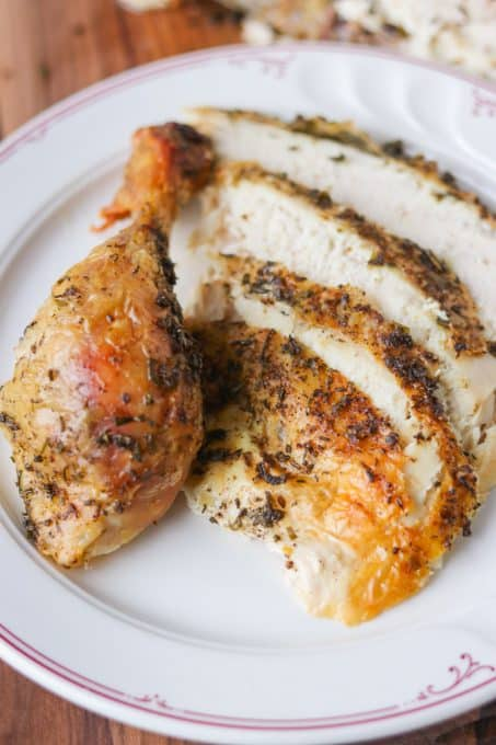 Slices and a drumstick of a Lemon Herb Roasted Chicken.