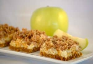 Caramel Apple Cheesecake Bars - cheesecake over a graham cracker crust covered with cinnamon apples, a streusel topping and drizzled with sweet caramel.