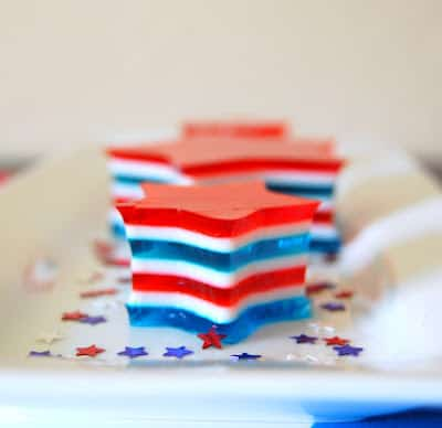 4th of July Jello Stars - layers of red, white and blue gelatin make up this colorful, and fun dessert to serve at all the Patriotic holidays!