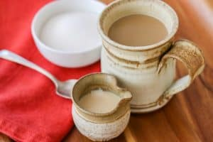 Homemade French Vanilla Coffee Creamer with a cup of coffee.