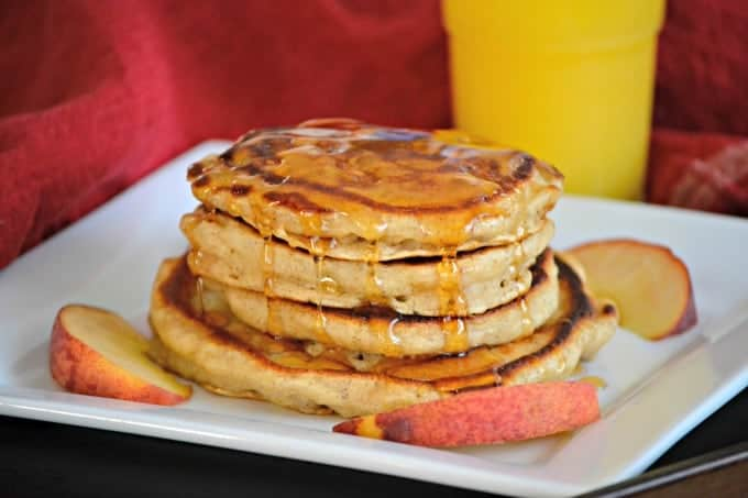 These Cinnamon Peach Pancakes are fluffy buttermilk pancakes spiced with cinnamon and flavored with fresh peaches - a great summer breakfast!