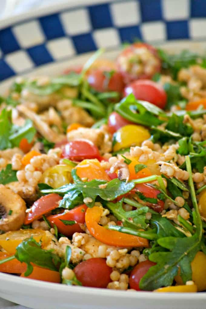 This delicious and easy Couscous Chicken Salad is made with pearl couscous, chicken, lots of veggies, and a bunch of flavor! It's great to eat warm for dinner and again the next day cold for lunch.