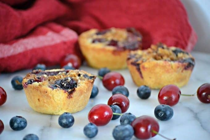 These Blueberry Cherry Mini Crumb Pies contain the fresh tastes of summer in a bite-sized treat!