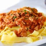 A plate of Crockpot Pork Ragu over some Pappardelle noodles.
