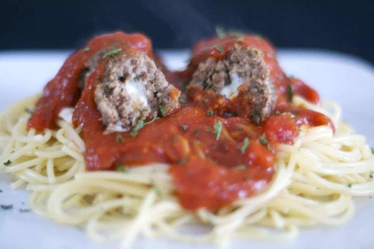 Meatballs made with onion and garlic, breadcrumbs, Parmesan and Romano cheeses, basil, oregano, onion and filled with a cube of mozzarella cheese to give your family or guests a tasty surprise as they cut into it.