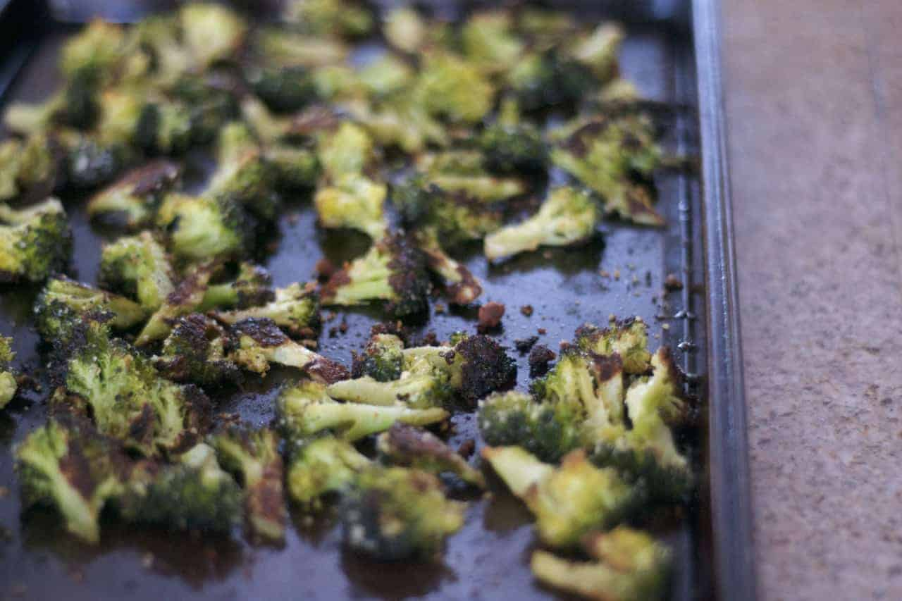 Broccoli tossed with olive oil, garlic powder and a touch of salt before being roasted in the oven to perfection~ from 365 Days of Baking & More.