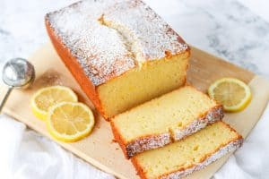 Sliced Lemon Ricotta Pound Cake on a cutting board.