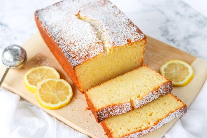 Sliced Lemon Ricotta Pound Cake on a cutting board.