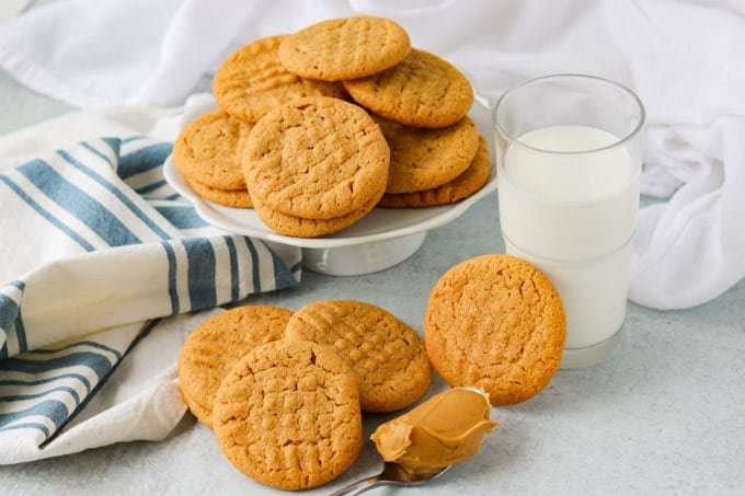 a pie plate full of peanut butter cookies.