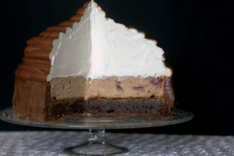 Neapolitan Hi-Hat Cake - a brownie, a strawberry cake, and Cool Whip. Delicious! From Surprise-Inside Cakes Cookbook