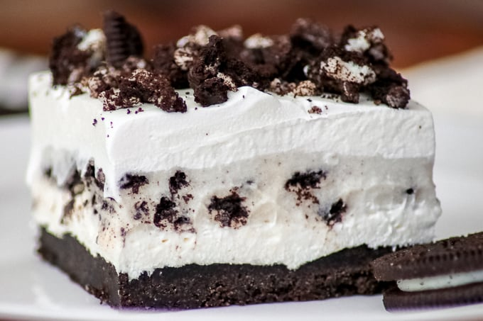 A slice of Oreo Pudding Dream Bars or Cookies and Cream Bars close up.