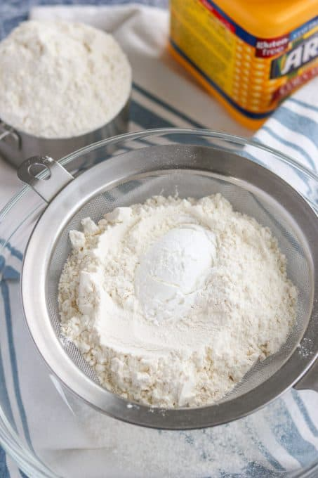 Flour and corn starch in a fine mesh sieve.