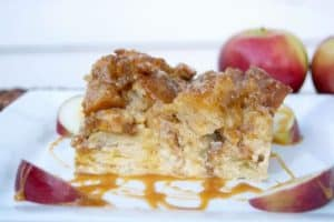 A taste of Fall with this baked French toast, apples, caramel sauce, and a cinnamon streusel topping - mornings at the table will never be the same!