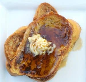 Eggnog French Toast - Challah bread dipped in an eggnog batter, browned to perfection and topped with homemade Maple Butter