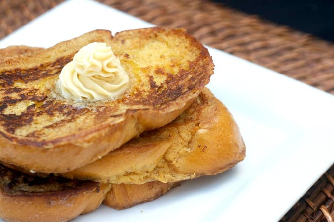 Eggnog French Toast - challah bread dipped in an eggnog batter, browned to perfection and topped with homemade Maple Butter.