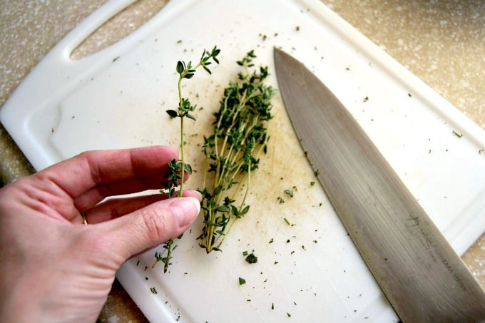 Removing fresh herbs like rosemary and thyme from their stems is easy with this little trick!