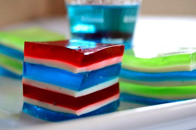 Game Day Jelly Shots - cubes of flavored gelatin in your favorite team colors spiked with flavored vodka for extra fun!