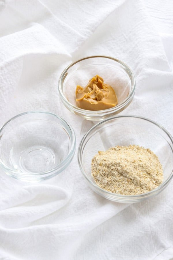 Water, creamy peanut butter, and ground oats are the ingredients for Homemade Dog Pill Pockets.