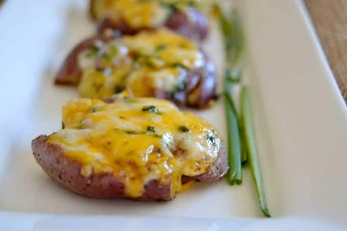 Smashed Roasted Cheesy Potatoes - roasted ruby gold potatoes smashed, seasoned and topped with Cheddar-Monterey Jack cheese to make an awesome side dish!