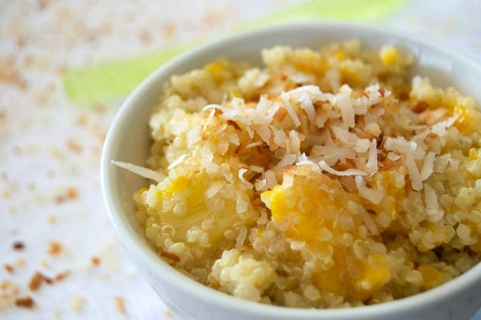 This salad of pineapple, mango and Mandarin oranges mixed with quinoa cooked in coconut milk is sure to remind you of a beach and warmer weather!