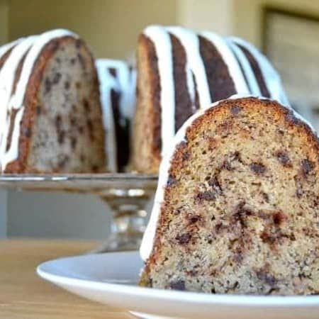 A moist delicious banana bundt cake filled with mini chocolate chips and drizzled with a cream cheese frosting!