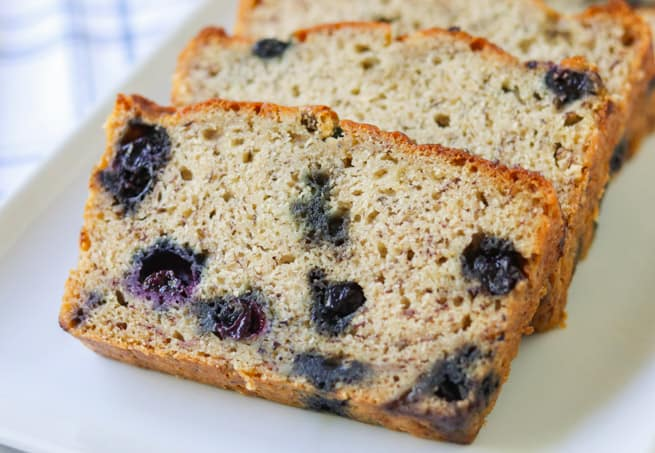 Thick layers of banana bread with blueberries.