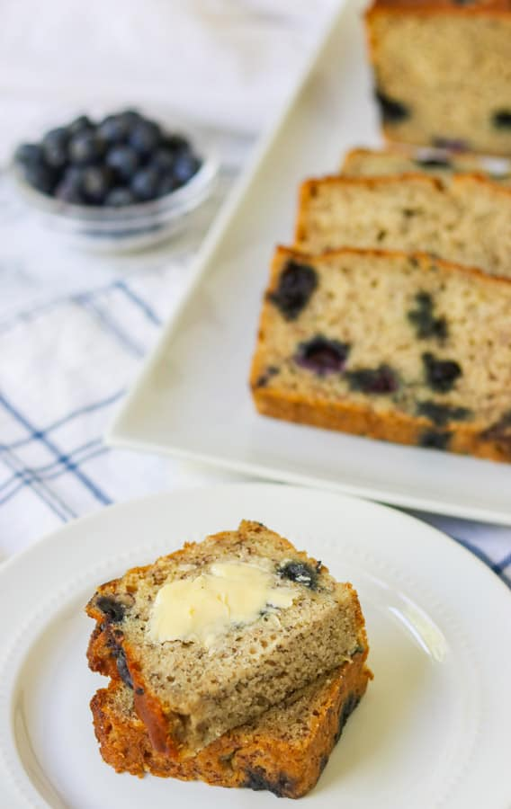 Buttered banana bread with blueberries.