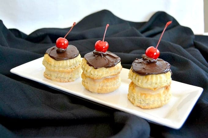 Boston Cream Puff Cakes - rounds of Pepperidge Farm Puff pastry filled with cream topped with chocolate ganache!