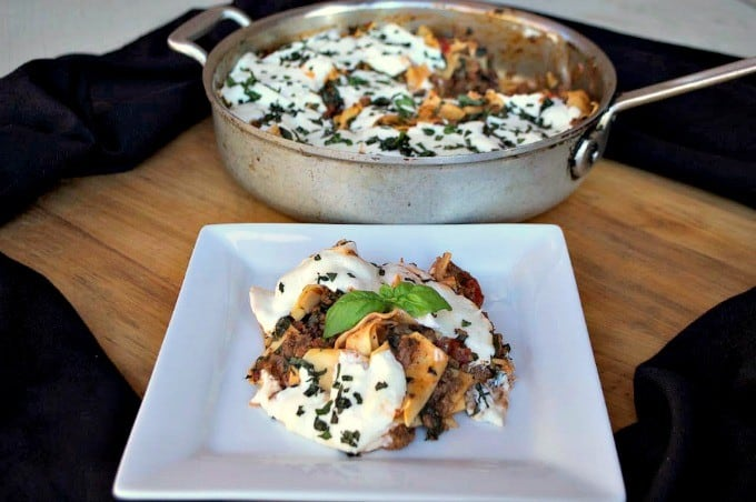 Lasagna made in a skillet with spinach. It makes for a great busy weeknight dinner!