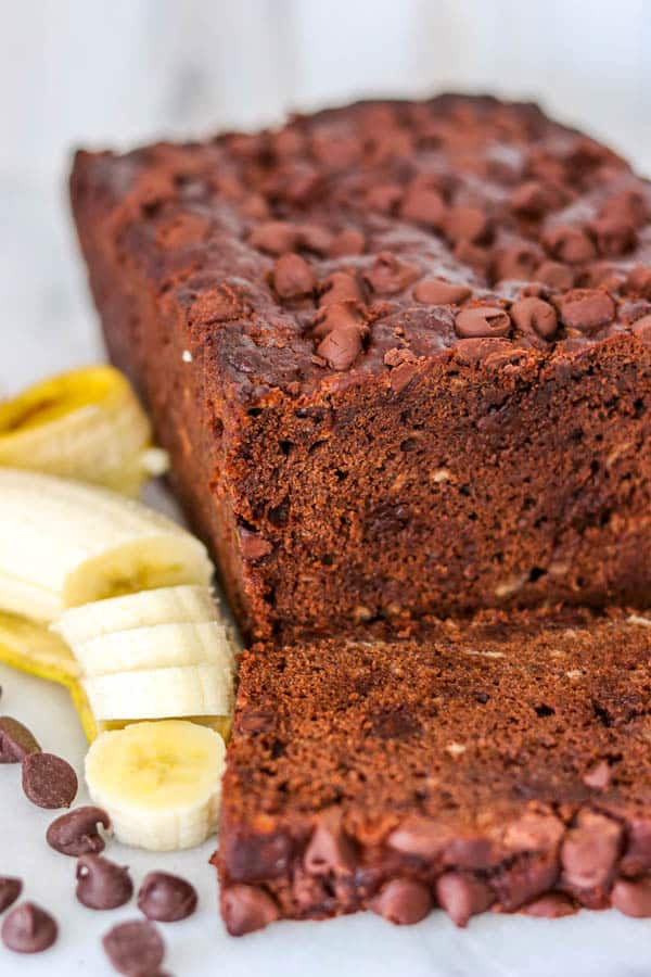 A loaf of Double Chocolate Banana Bread - banana bread with double chocolate from cocoa powder and chocolate chips.