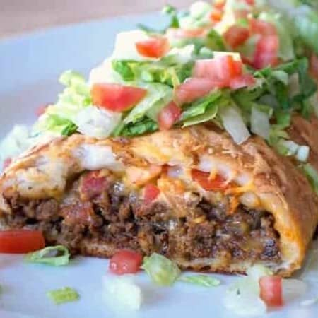 Taco seasoned ground beef, cheese, and tomato rolled in a pizza dough.