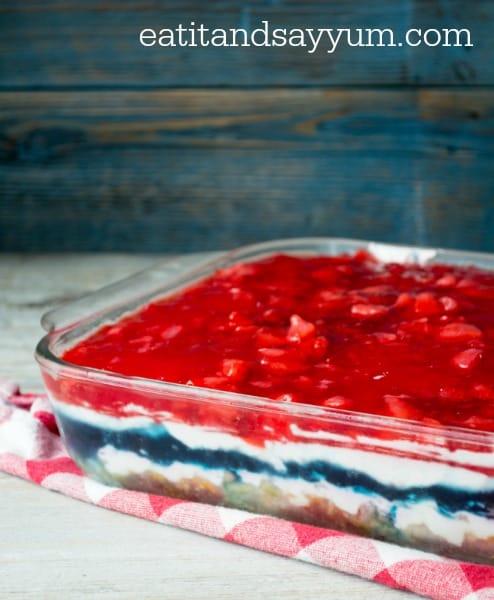 Patriotic Jello Dessert with cream cheese layers and pretzel crust