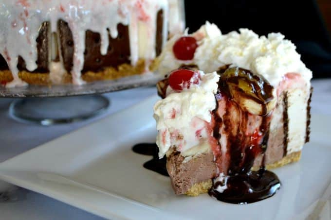 Layers of chocolate and strawberry ice cream, ice cream sandwiches, bananas, chocolate, pineapple and strawberry sundae toppings, and of course, whipped cream and cherries! WOW!