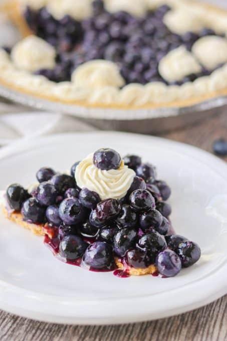 A slice of a No Bake Blueberry Pie.