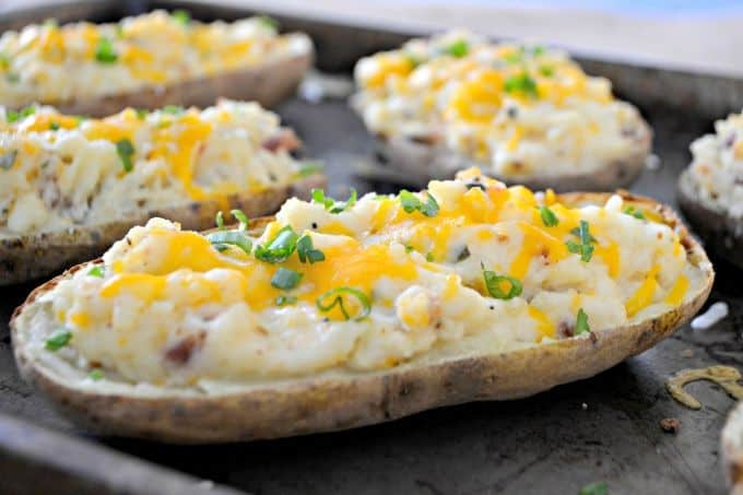 These Twice Baked Potatoes are baked then mixed with cream cheese, Greek yogurt, Old Bay Seasoning and bacon. They'll complement your meat dish very well!