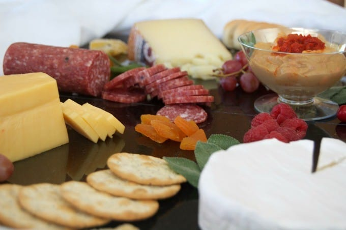Creating a colorful, appealing and tasty cheese board for entertaining is easy with these ingredients!