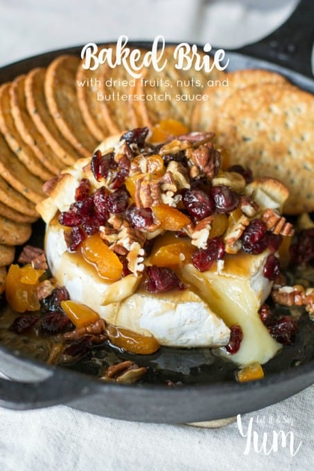 Baked Brie with dried fruits, nuts, and butterscotch sauce- a great holiday appetizer